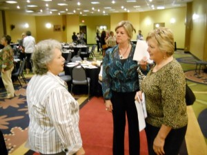 Patsy visiting with two of the Chamber of Commerce women
