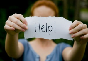 "Wife holding up ""Help!"" sign"