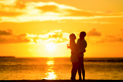 couple-on-beach-with-sunset-400x267